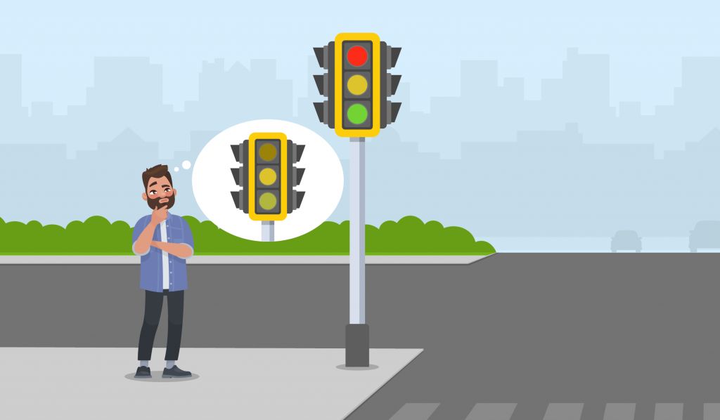 colour blind pedestrian standing next to the traffic light
