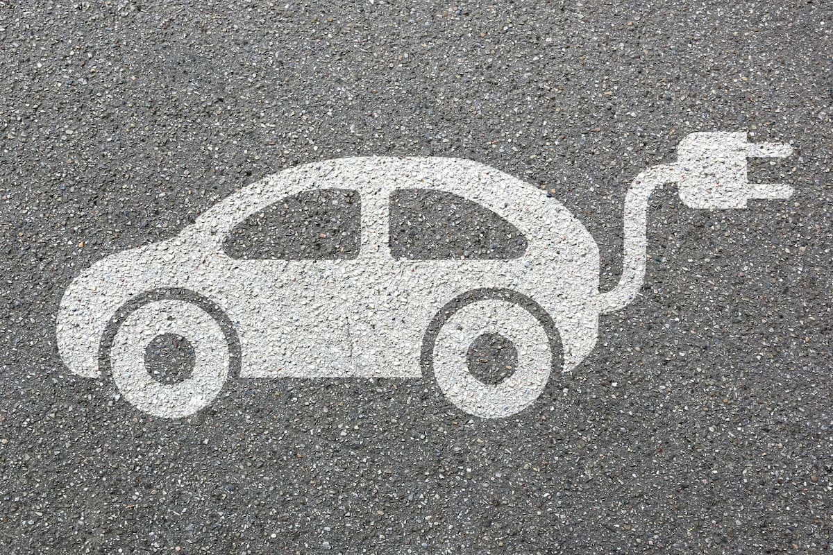 Electric Car Sign on the Ground